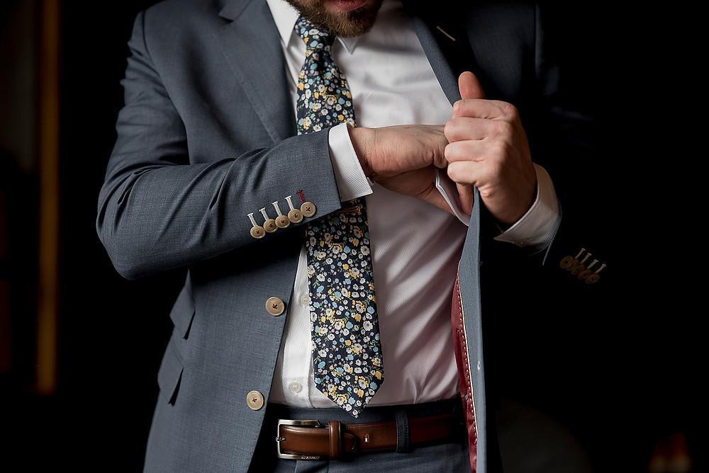 whistler groom places wedding speach inside jacket pocket