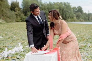 indian-bride-groom-smiling-signing-marriage-license-after-elopement