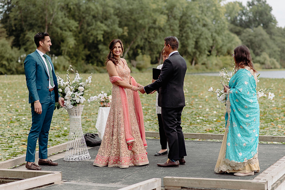 bride smiles at family during elopement ceremony