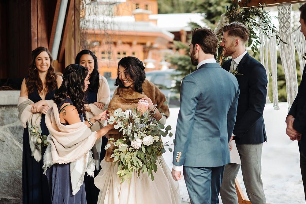 whistler bride smiles toward sister during nita lake ceremony