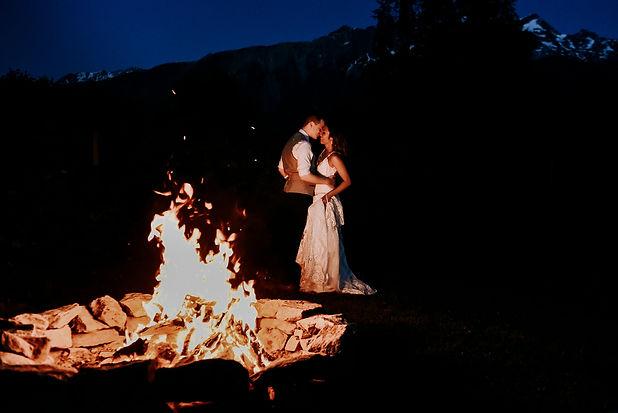 Couple share first dance beside bonfire