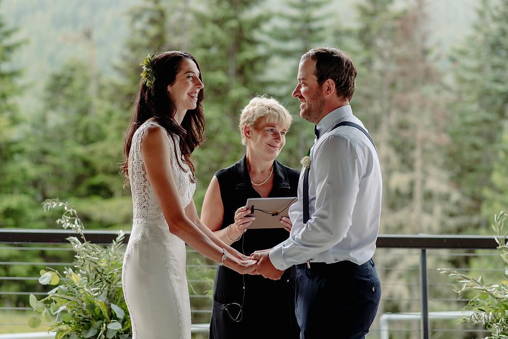 smiling bride groom during ceremony whistler sliding center