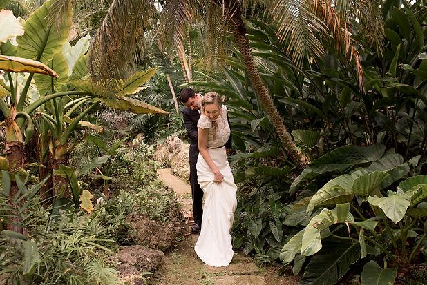 wedding couple walk through jungle in Barbados for tropical wedding