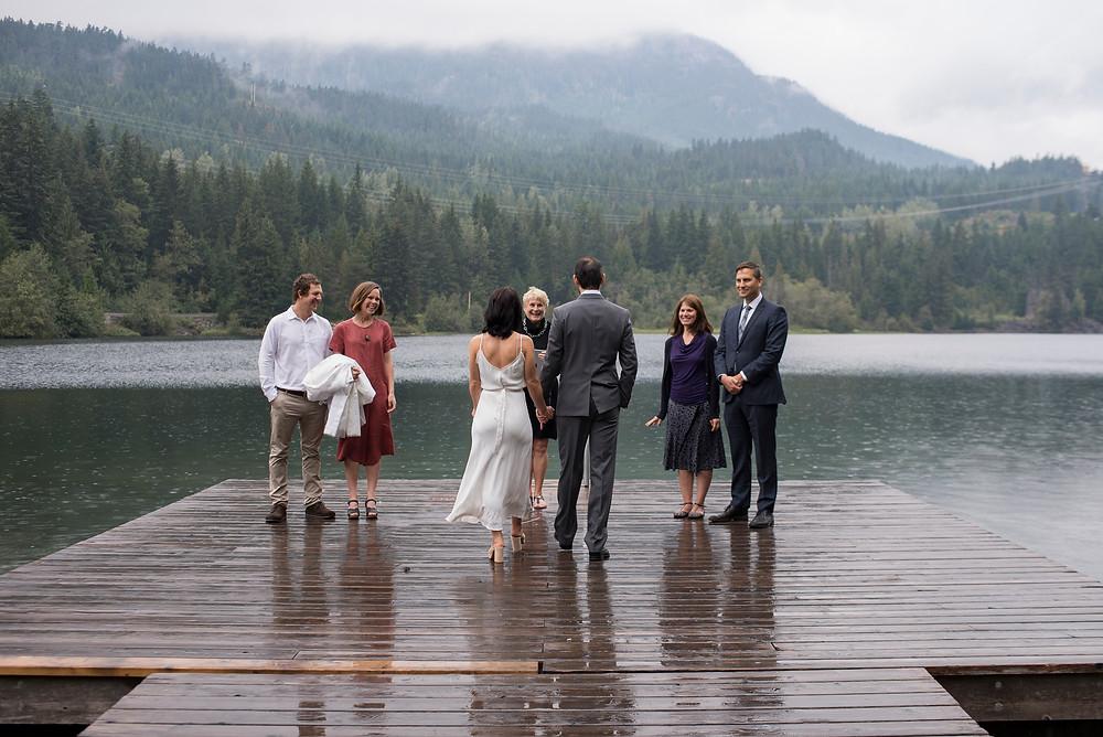 bride groom saying vows on dock nita lake