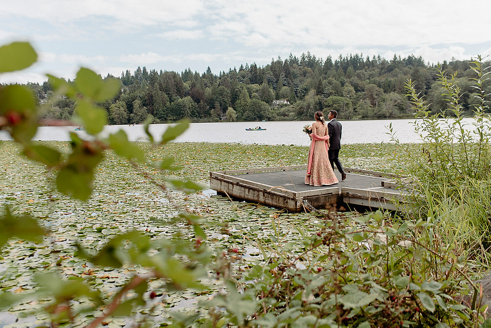 bride groom stand on dock at vancouver lake