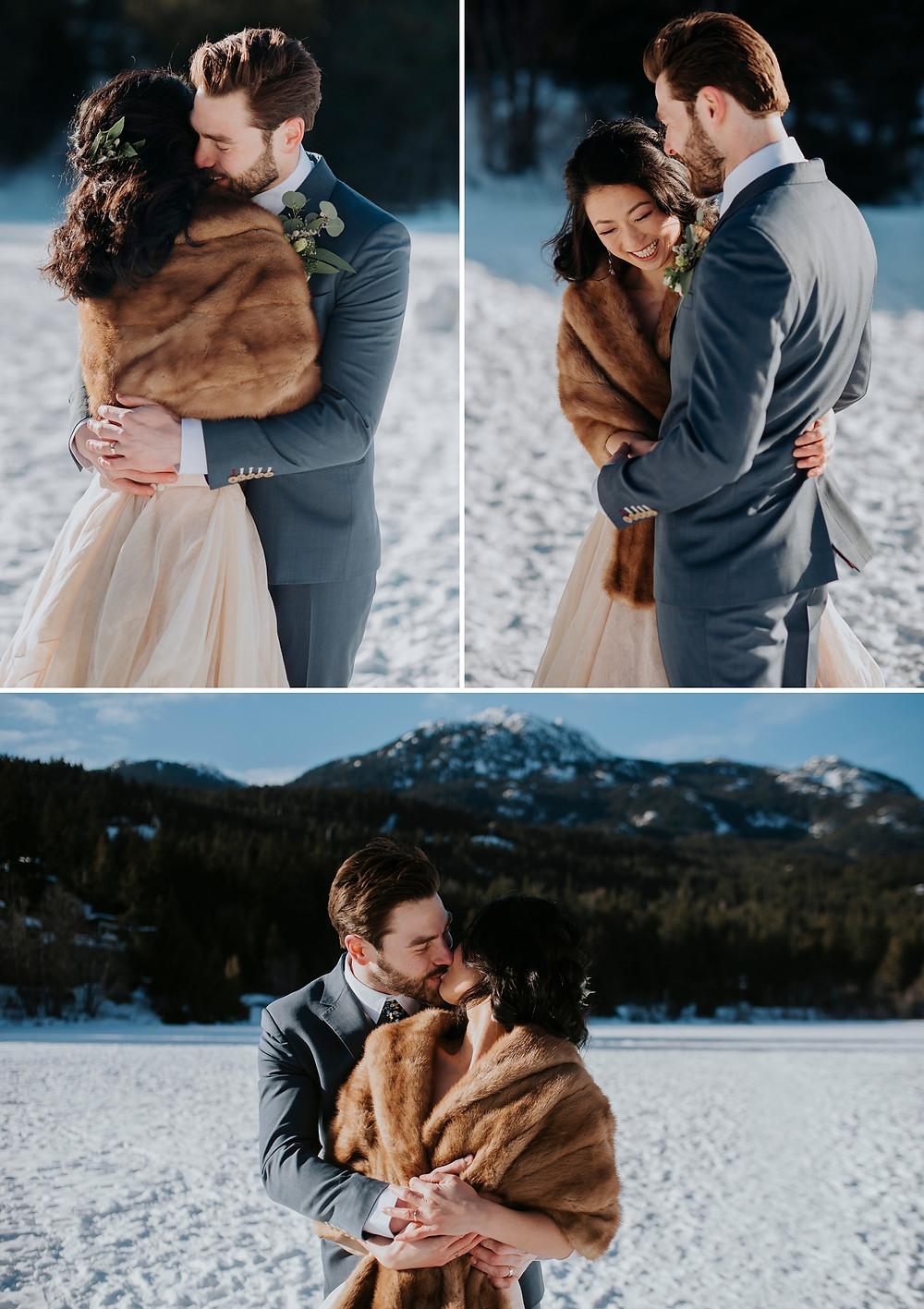 Bride groom cuddle on frozen Nita Lake in the sunshine during Whistler winter elopement