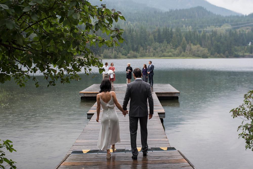 bride groom walking down dock whistler elopement