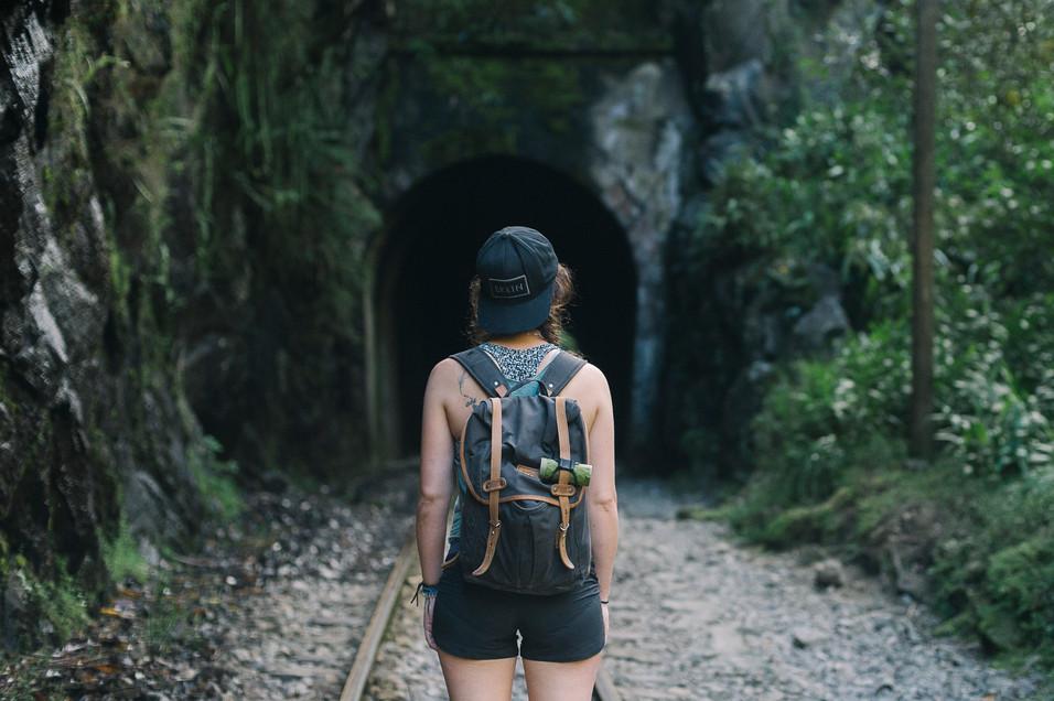 girl-walks-train-tracks-to-aguas-calientes-peru