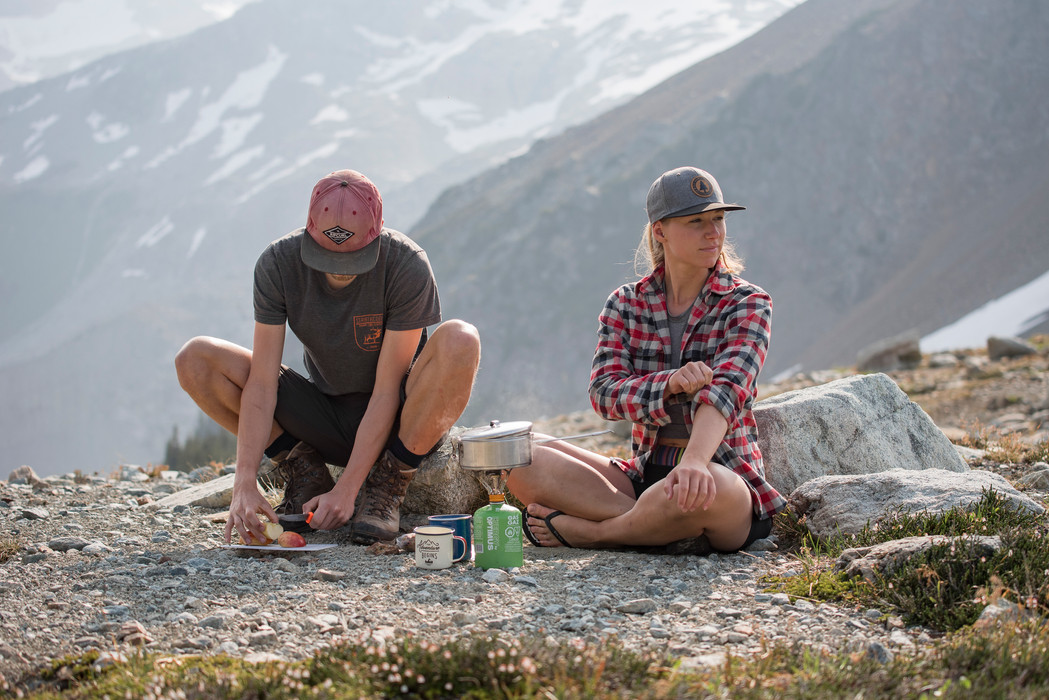 couple-having-backcountry-camping-breakfast-made-with-camping-stove-in-morning-alpine-light-whistler-british-columbia