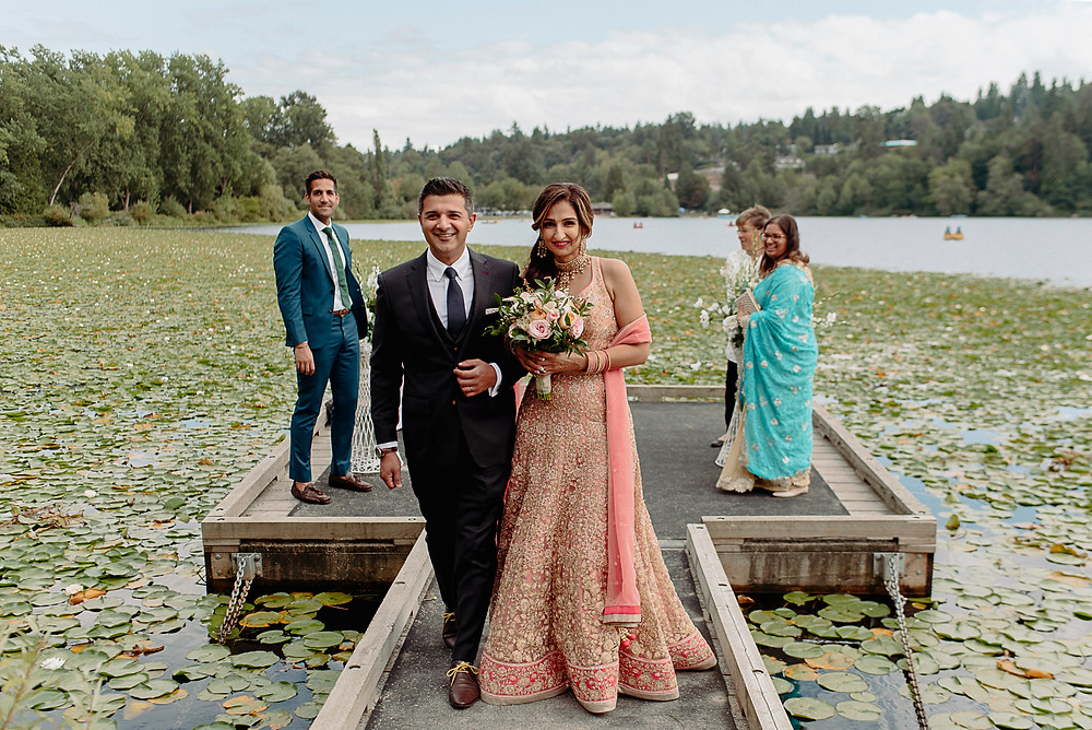 bride groom walk down aisle after lakeside ceremony