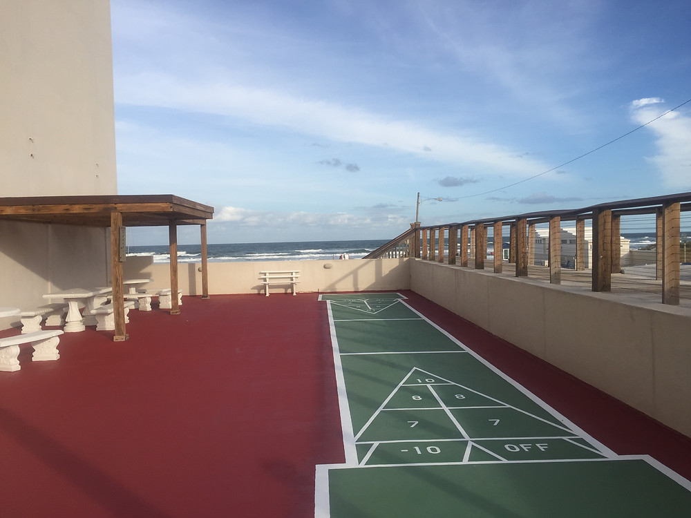 The shuffleboard court is freshly painted and ready.