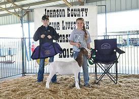 Dally Bruns-Houx with her supreme champion doe & champion junior showman