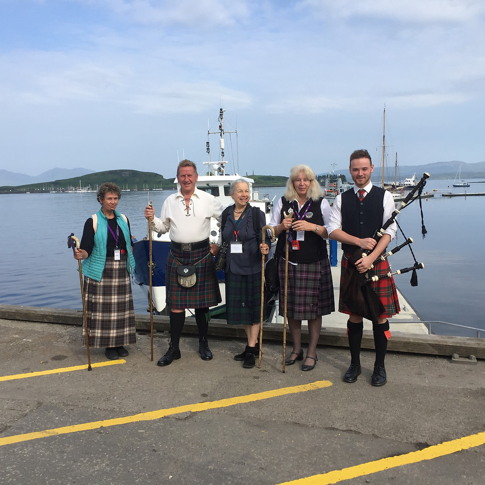 Walking guides eager to share the story of Oban to cruise ship passengers.