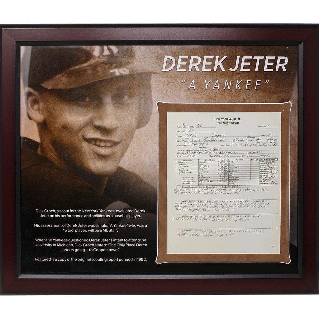 Derek Wolfe has hand signed this 8x1
