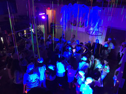 dance floor with hanging glow sticks