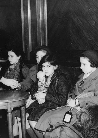 Jewish refugee children of first Kindertransport arrive in Harwich, England, girl with doll is Helga Kreiner