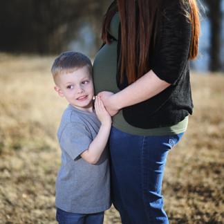 son hugging pregnanyt mom's belly