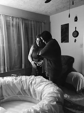 Doula providing support at home birth