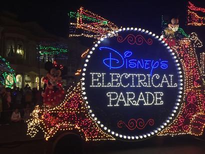 Disney's electrical parade at night inside Orlando's Disney World