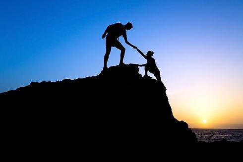 Man and woman climbing moountain .jpeg