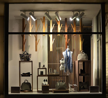 Boutique window with shoes, bags and man