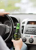 man-drinking-alcohol-while-driving-the-c