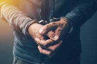 arrested-computer-hacker-with-handcuffs-