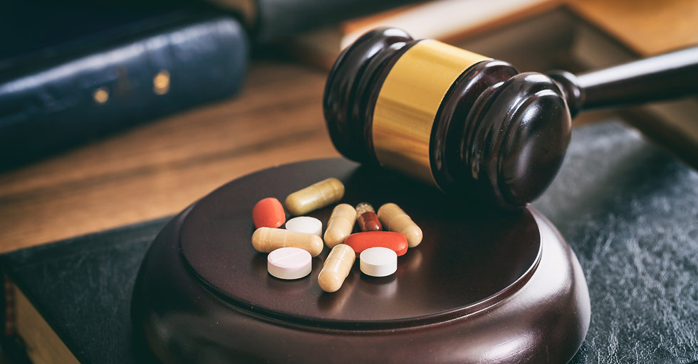judge-gavel-and-drugs-on-a-wooden-desk-P