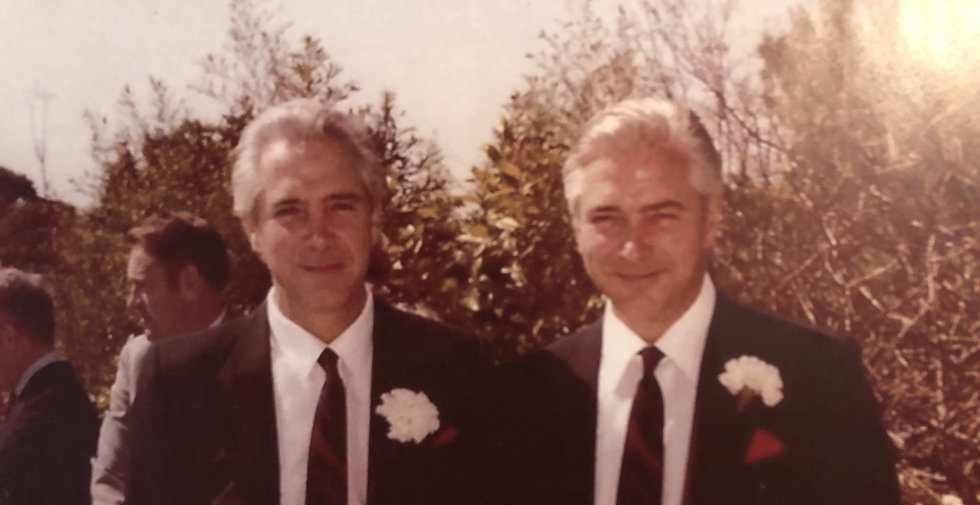 Our co-founders, Nicholas Meyer (left) and Michael Meyer (right) dressed in suits