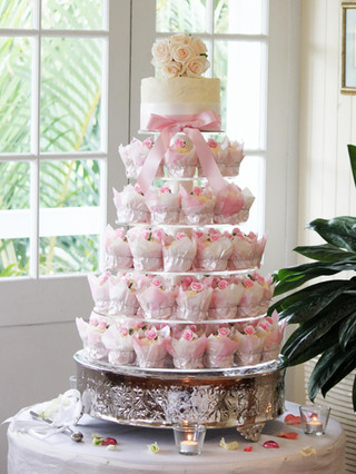 Wedding cupcake tower in cream and pinks