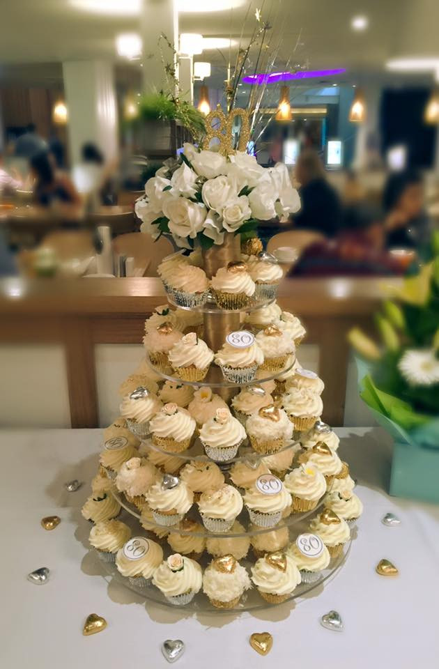 80th birthday cupcakes in a gold and silver theme