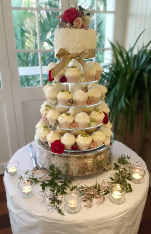 wedding cupcake tower and small cake with fresh flowers