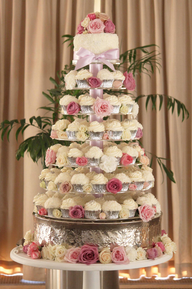 wedding cupcake tower and small cake with fresh roses