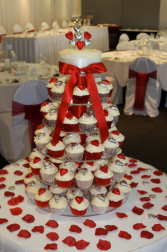 wedding cupcake tower with silver and red hearts