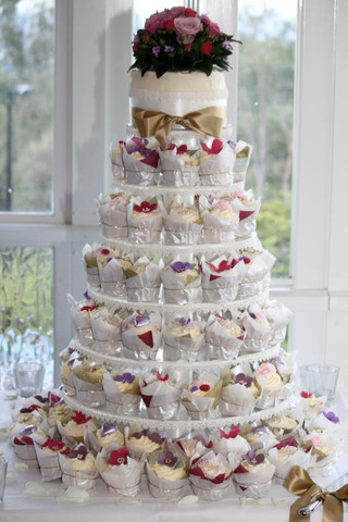 Vintage cupcake tower and small cake for wedding
