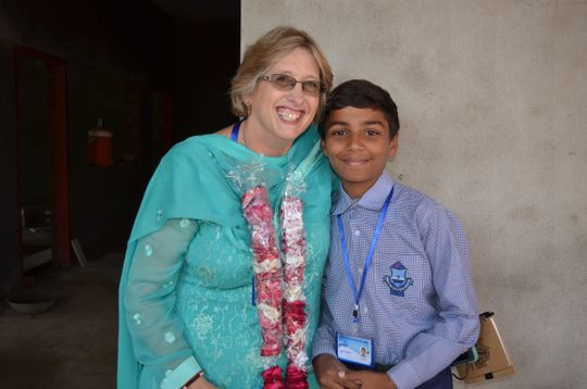 Amy Nicholson with a Pasrur Christian Boys' School Student.
