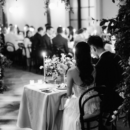 Wedding couple at sweet heart table