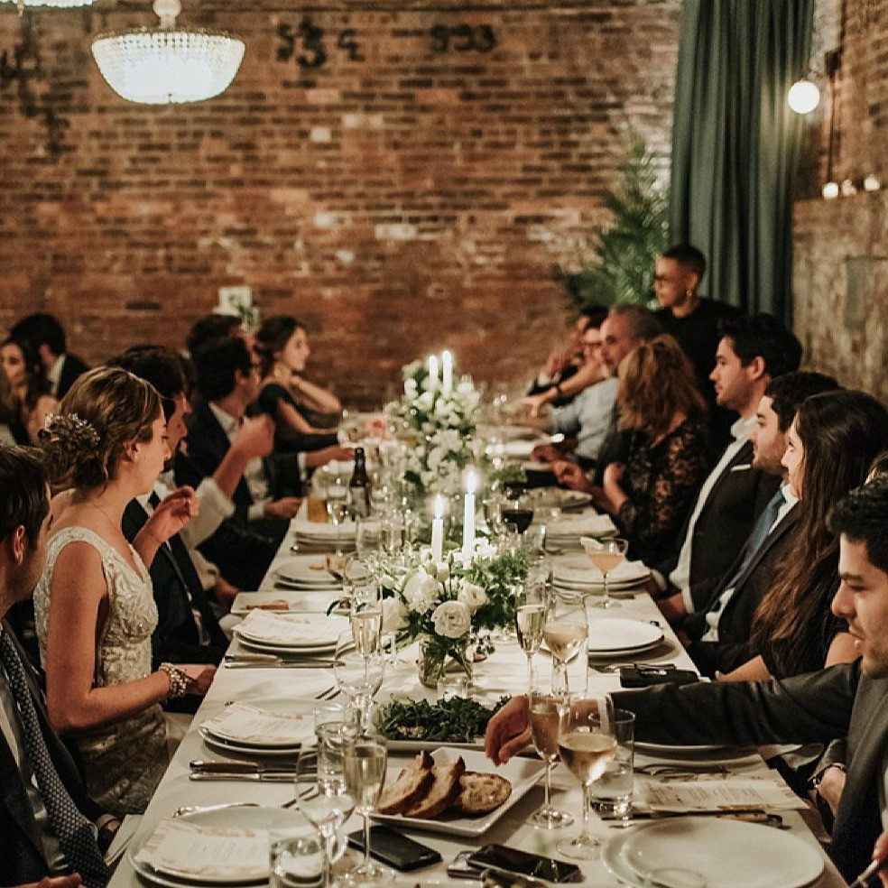 Wedding dinner table with white linens