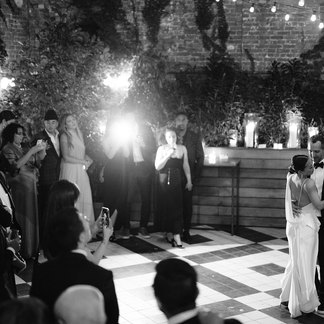 Formal wedding couple first dance outside on black and white tiled floor