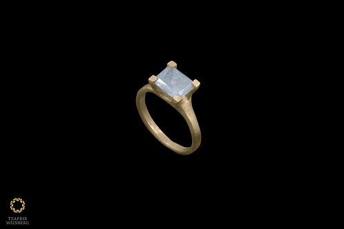 22k gold ring set with a gray diamond