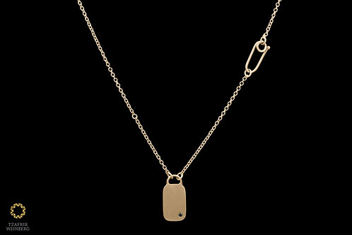 "18k Yellow gold necklace with black diamond studed ""bag"" shaped pendant"