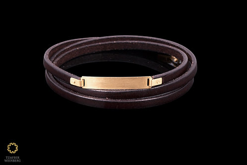Leather and 18k yellow goldbracelet, with 18k gold lock