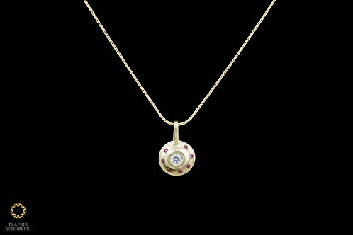 18k gold necklace,pendant with 0.10ct colored central diamond andRuby around