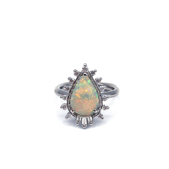 Custom Opal Engagement Ring with Diamond Halo and Baguette Diamond Tail feathers in Platinum; Heirloom Opal Redesign