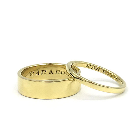 Custom Modern His and Hers Wedding Bands with Diamond Detail and Personalized Engraving in 18k Recycled Yellow Gold