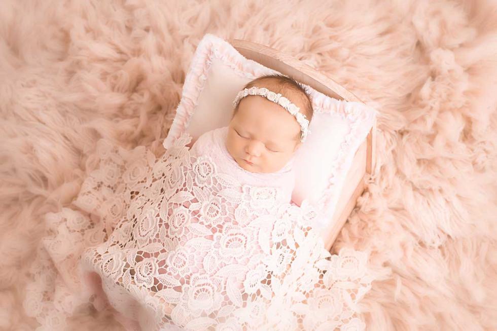 newborn-portrait-in-miniture-bed.jpg