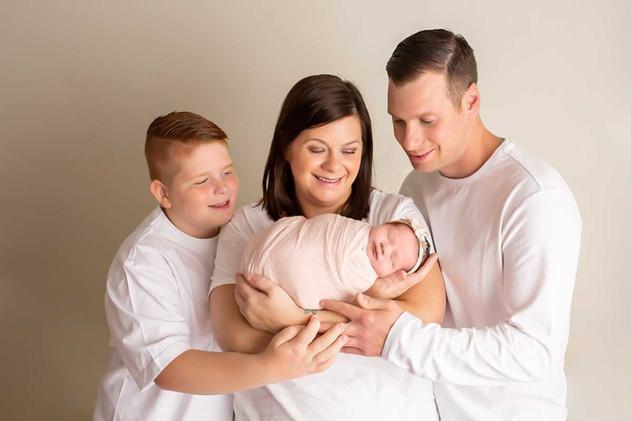 professional-family-pose-newborn.jpg