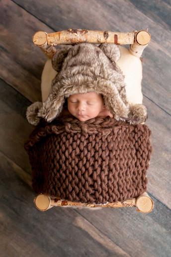 newborn-photograph-rustic-racoon-hat.jpg