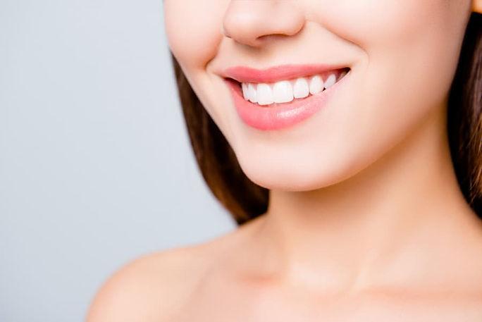 woman-with-beautiful-teeth-smiling.jpg