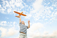 The child plays with a plane and launche